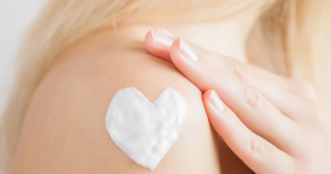 lotion-shaped-heart on a woman's shoulder